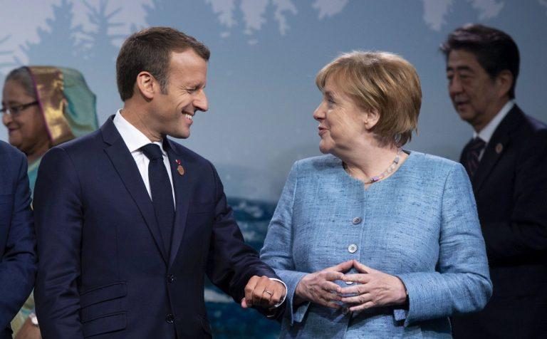 Emmanuel Macron ja Angela Merkel G7 tippkohtumisel Kanadas, kus lõid välja erimeelsused USAga.